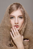 Woman with scarf Stock Images