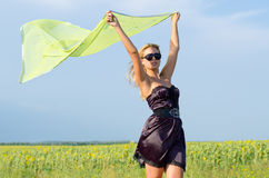 Woman with scarf fluttering in the breeze Stock Photos