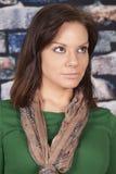 Woman scarf green shirt brick wall look up stock image