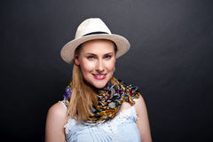 Woman with scarf and hat over dark background Royalty Free Stock Images