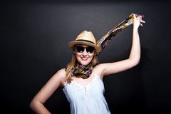 Woman with scarf and hat over dark background Stock Photos