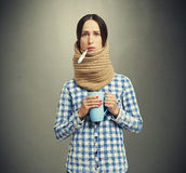 Woman in scarf have a flu Royalty Free Stock Photos