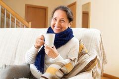 Woman in scarf  at home Stock Photography