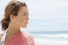Woman With Scarf Looking Away On Beach Royalty Free Stock Images