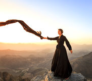 Woman with a scarf in the mountains Royalty Free Stock Photography