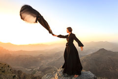 Woman with a scarf in the mountains Royalty Free Stock Images