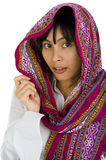 Woman with scarf over her head. Beautiful young woman with scarf over her head, isolated on white Royalty Free Stock Photography