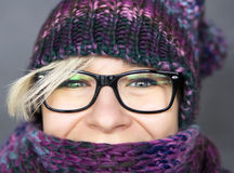 Woman in scarf. Portrait of happy woman in winter cap and scarf Royalty Free Stock Photo