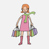 Woman with scarf and shopping bags Royalty Free Stock Photography