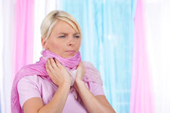 Woman with scarf and sore throat Royalty Free Stock Photos