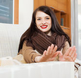 Woman  in scarf  warming near warm heater Stock Photos