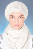 Woman with scarf and winter cap Royalty Free Stock Image