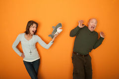 Woman Scaring Man With Fur Toy Stock Images