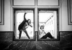 Woman scaring window Stock Photo