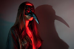 Woman with scary mask Stock Photography
