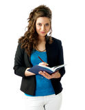 Woman with schedule. Attractive woman consulting her schedule Stock Photo