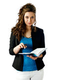 Woman with schedule. Attractive woman consulting her schedule Stock Images