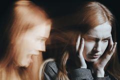 Woman with schizophrenia hearing voices Stock Photography