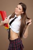 Woman in a schoolgirl costume Stock Photos