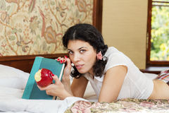 Woman in schoolgirl hold bited apple Royalty Free Stock Photos