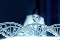 Woman science technologist in laboratory. Woman scientist examining DNA molecule image at media screen Royalty Free Stock Image