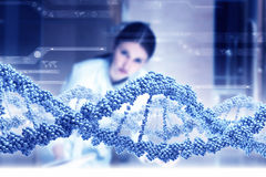 Woman science technologist in laboratory. Woman scientist examining DNA molecule image at media screen Stock Photo