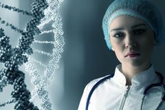 Woman science technologist in laboratory. Woman scientist at media background of DNA molecule Royalty Free Stock Image