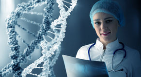 Woman science technologist in laboratory. Woman scientist at media background of DNA molecule Stock Images