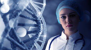 Woman science technologist in laboratory. Woman scientist at media background of DNA molecule Royalty Free Stock Photos