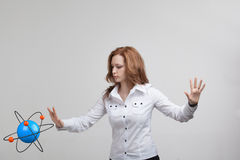 Woman scientist with atom model, research concept Stock Images