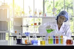 The woman scientist doing experiment with flare light in laboratory. royalty free stock photos
