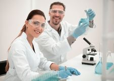 Woman scientist and her assistant working in the laboratory. Science and health Stock Photo