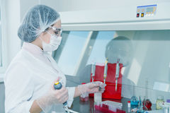 Woman scientist in a lab Stock Images