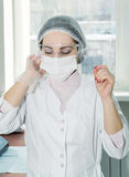 Woman scientist in a lab Royalty Free Stock Image