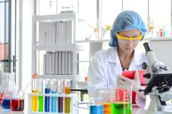 Woman scientist doing experiment. stock images