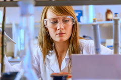 Woman scientist in laboratory Royalty Free Stock Image