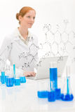 Woman scientist in laboratory with laptop Stock Photos