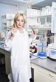 Woman  scientist with laboratory pipettes. Royalty Free Stock Photography