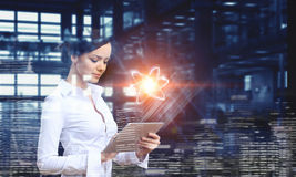 Woman scientist making research. Mixed media stock images