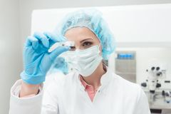 Woman scientist showing her newest biotech experiment in lab Stock Photo