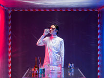 Woman scientist smelling a liquid substance Stock Image