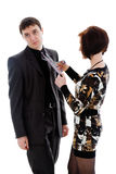 Woman scissor tie, young man. Royalty Free Stock Image