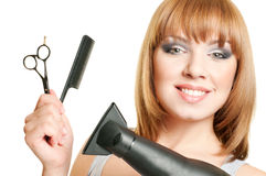 Woman with scissors, comb and hairdryer Royalty Free Stock Photos