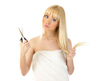 Woman with scissors looking surprised Royalty Free Stock Photos