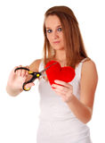 Woman with scissors and red heart. Young beatiful woman cutting with scissors red heart Stock Photo