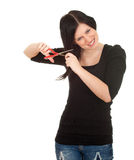 Woman with a scissors trying to cut her hair Royalty Free Stock Photo