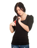 Woman with a scissors trying to cut her hair Royalty Free Stock Photography