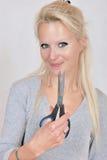 Woman with scissors Stock Photos
