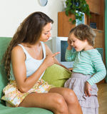 Woman scolding child at home Stock Images