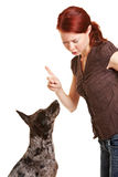 Woman scolding her dog Royalty Free Stock Photo